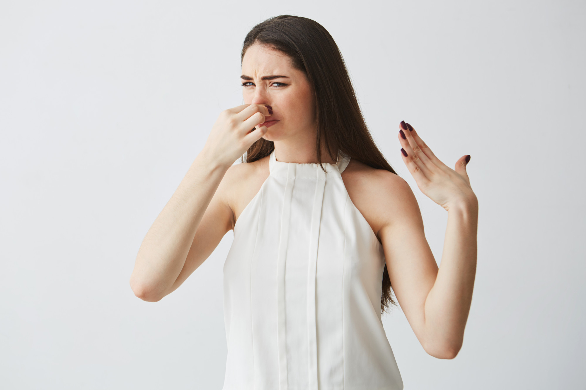 young-brunette-girl-closing-covering-nose-bad-smell
